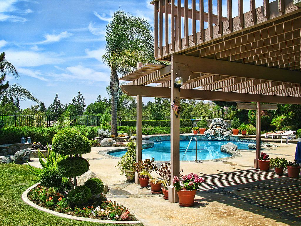 backyard with deck and pool
