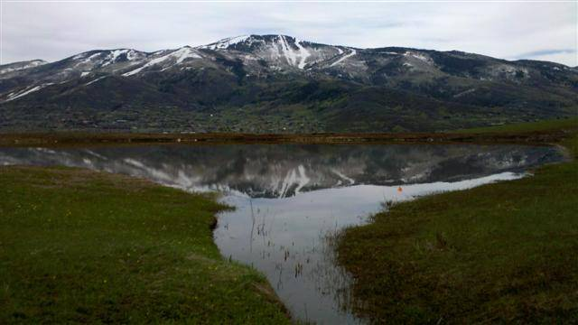 The pond reflects the Ski Area