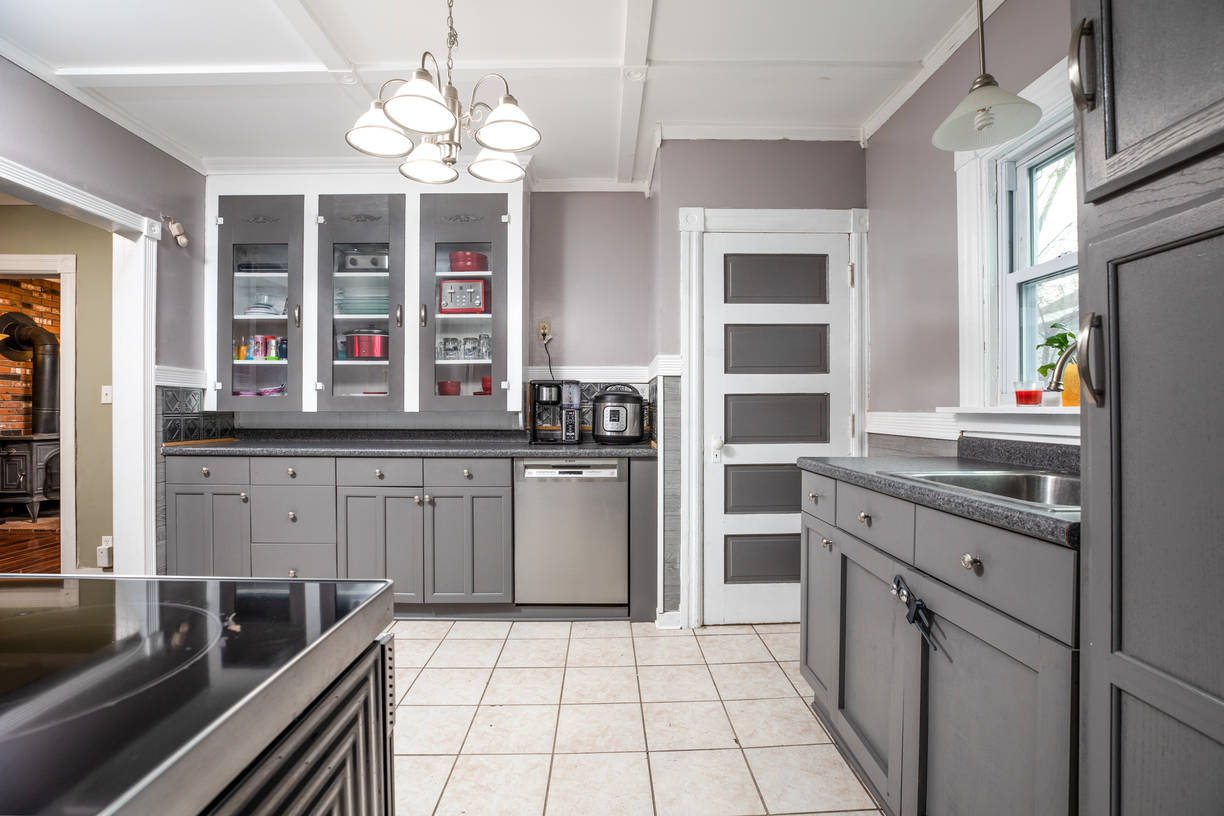 Love the coffered ceiling-glass faced cabinets